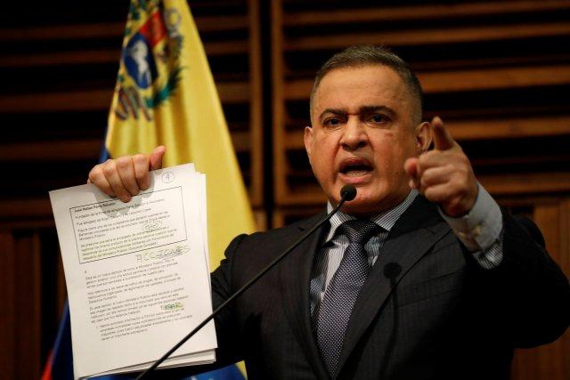 Venezuela's chief prosecutor Tarek William Saab shows documents during a news conference in Caracas, Venezuela, August 31, 2017. REUTERS/Andres Martinez Casares