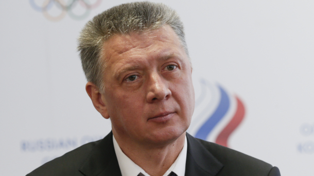 Newly-elected Russian Athletics Federation president Dmitry Shlyakhtin attends a news conference in Moscow, Russia, Saturday, Jan. 16, 2016. The Russian athletics federation elected a politically connected former coach as its new president Saturday as it tries to end the country's suspension from Olympic track and field. Dmitry Shlyakhtin, a regional sports minister in the Samara region of central Russia, was elected unanimously after his main rival withdrew as part of a deal brokered by senior Russian officials. (AP Photo/Pavel Golovkin)