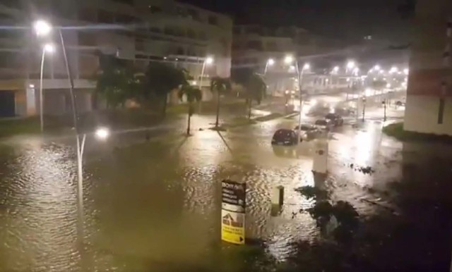 "This handout picture obtained from a video released on September 19, 2017, on the Twitter account of Yves Thole shows a flooded street in Pointe-a-Pitre after the powerful winds and rain of hurricane Maria battered the French overseas Caribbean island of Guadeloupe. Hurricane Maria strengthened into a ""potentially catastrophic"" Category Five storm as it barrelled into eastern Caribbean islands still reeling from Irma, forcing residents to evacuate in powerful winds and lashing rain. / AFP PHOTO / TWITTER / Yves THOLE / RESTRICTED TO EDITORIAL USE - MANDATORY CREDIT ""AFP PHOTO / TWITTER / YVES THOLE"" - NO MARKETING NO ADVERTISING CAMPAIGNS - DISTRIBUTED AS A SERVICE TO CLIENTS"