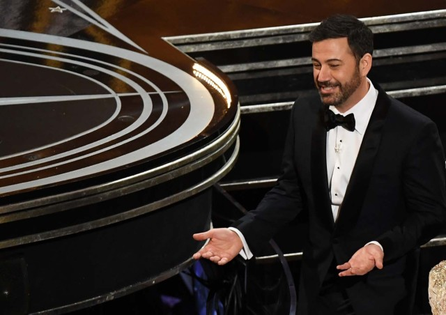 (FILES) This file photo taken on February 26, 2017 shows Host Jimmy Kimmel reacting after the 89th Oscars in Hollywood, California. Late-night comedian Jimmy Kimmel has emerged as the unlikely town crier against the latest Republican plan to overhaul Obamacare, highlighting his son's heart disease in an emotional new appeal to salvage America's health care system. For two straight nights he has stood on stage at an ABC studio in Los Angeles and, using his own son's harrowing story as an example of the extraordinary costs of emergency treatment, argued that poor and middle class families would be priced out of health care under the new plan. / AFP PHOTO / Mark RALSTON