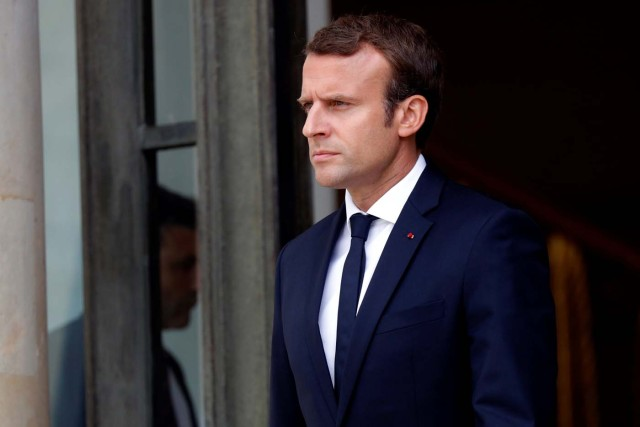 French President Emmanuel Macron waits for guests at the Elysee Palace in Paris, France, August 31, 2017. REUTERS/Philippe Wojazer