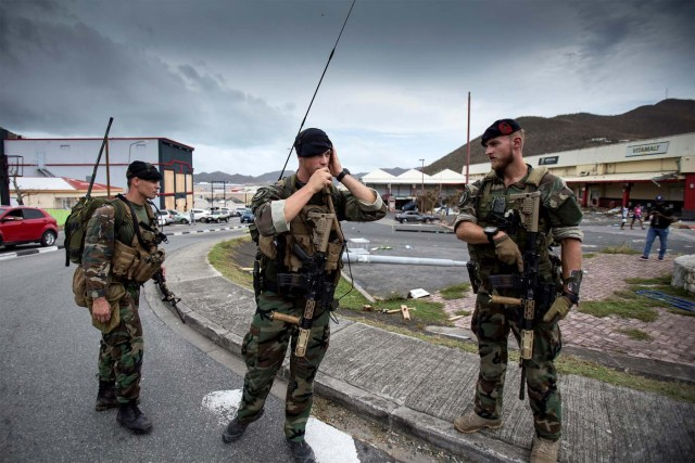 Dutch soldiers patrol the streets of Sint Maarten Dutch part of Saint Martin island in the Carribean after the Hurricane Irma September 7, 2017. Picture taken September 7, 2017. Netherlands Ministry of Defence- Gerben van Es/Handout via REUTERS ATTENTION EDITORS - THIS IMAGE HAS BEEN SUPPLIED BY A THIRD PARTY. MANDATORY CREDIT.NO RESALES. NO ARCHIVES