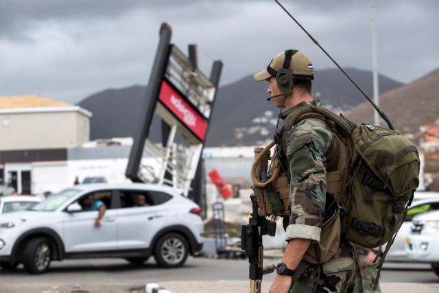 A dutch soldier patrols the streets of Sint Maarten Dutch part of Saint Martin island in the Carribean after the Hurricane Irma September 7, 2017. Picture taken September 7, 2017. Netherlands Ministry of Defence-Gerben van Es/Handout via REUTERS ATTENTION EDITORS - THIS IMAGE HAS BEEN SUPPLIED BY A THIRD PARTY. MANDATORY CREDIT.NO RESALES. NO ARCHIVES
