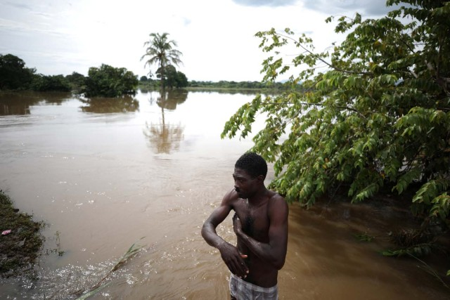 A man takes a bath in a flooded area after Hurricane Irma in Fort Liberte, Haiti, September 8, 2017. REUTERS/Andres Martinez Casares