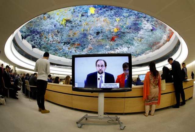 Zeid Ra'ad Al Hussein, U.N. High Commissioner for Human Rights is pictured on a screen during his speech at the 36th Session of the Human Rights Council at the United Nations in Geneva, Switzerland September 11, 2017. Picture taken with a fisheye lens. REUTERS/Denis Balibouse