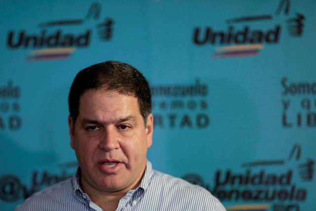 Luis Florido, lawmaker of the Venezuelan coalition of opposition parties (MUD) talks to the media during a news conference in Caracas, Venezuela, September 16, 2017. REUTERS/Marco Bello