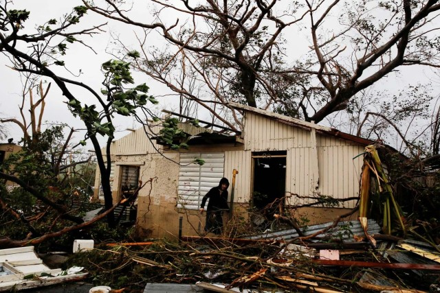 A man looks for valuables in the damaged house of a relative after the area was hit by Hurricane Maria in Guayama, Puerto Rico September 20, 2017. REUTERS/Carlos Garcia Rawlins TPX IMAGES OF THE DAY