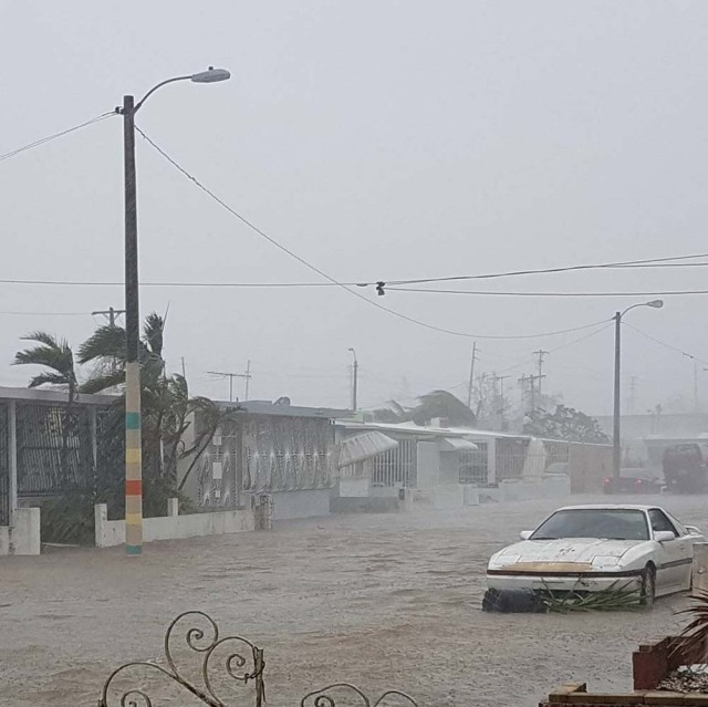 A car drives through a flooded street after Hurricane Maria hit San Juan, Puerto Rico, September 20, 2017 in this image taken from a social media. Sebastian Perez via REUTERS THIS IMAGE HAS BEEN SUPPLIED BY A THIRD PARTY. MANDATORY CREDIT.NO RESALES. NO ARCHIVES