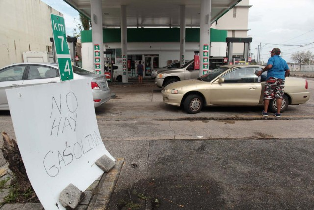 """People arrive to buy gasoline next to a sign reading """"There is no gasoline,"""" at a gas station, after the area was hit by Hurricane Maria, in San Juan, Puerto Rico September 22, 2017. Picture taken September 22, 2017. REUTERS/Alvin Baez"""