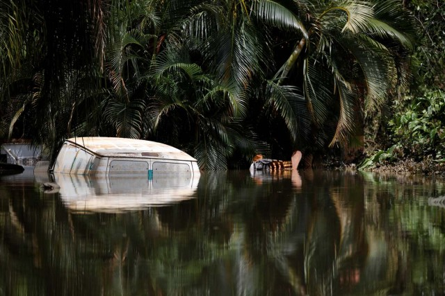 A car submerged in flood waters is seen close to the dam of the Guajataca lake after the area was hit by Hurricane Maria in Guajataca, Puerto Rico September 23, 2017. REUTERS/Carlos Garcia Rawlins