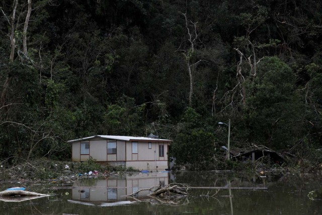 Houses damaged by flood waters are seen close to the dam of the Guajataca lake after the area was hit by Hurricane Maria in Guajataca, Puerto Rico September 23, 2017. REUTERS/Carlos Garcia Rawlins