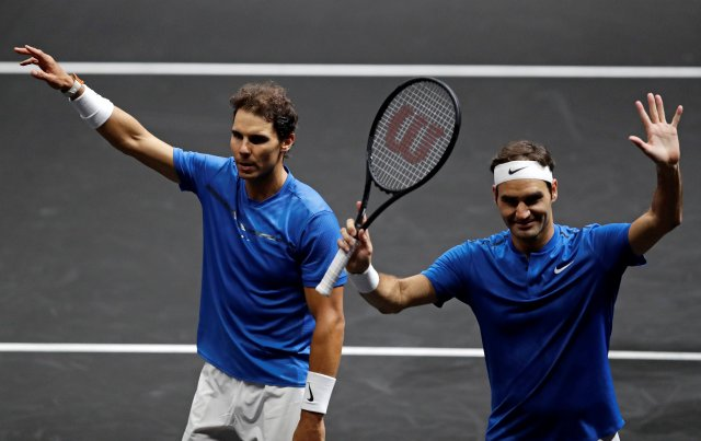 Tennis - Laver Cup - 2nd Day - Prague, Czech Republic - September 23, 2017 - Rafael Nadal and Roger Federer of team Europe react the match. REUTERS/David W Cerny