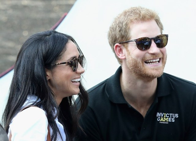 TORONTO, ON - SEPTEMBER 25: Prince Harry (R) and Meghan Markle (L) attend a Wheelchair Tennis match during the Invictus Games 2017 at Nathan Philips Square on September 25, 2017 in Toronto, Canada Chris Jackson/Getty Images for the Invictus Games Foundation /AFP
