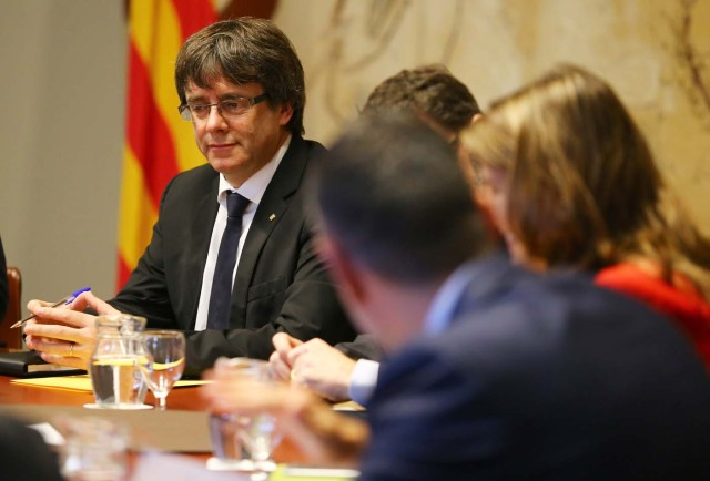 Catalan President Carles Puigdemont presides over a cabinet meeting at the regional government headquarters, the Generalitat, in Barcelona, Spain October 10, 2017. REUTERS/Ivan Alvarado