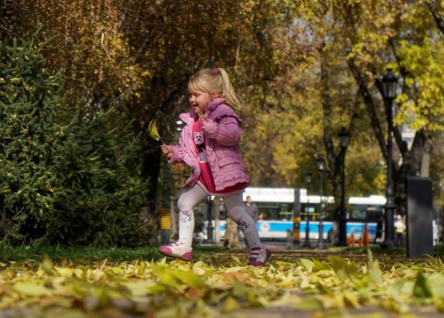 A girl runs in a park on a sunny autumn day in Almaty, Kazakhstan October 13, 2017. REUTERS/Shamil Zhumatov