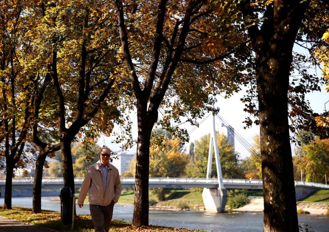 A man walks on a warm autumn day in the central town park in Zenica, Bosnia and Herzegovina, October 13, 2017. REUTERS/Dado Ruvic