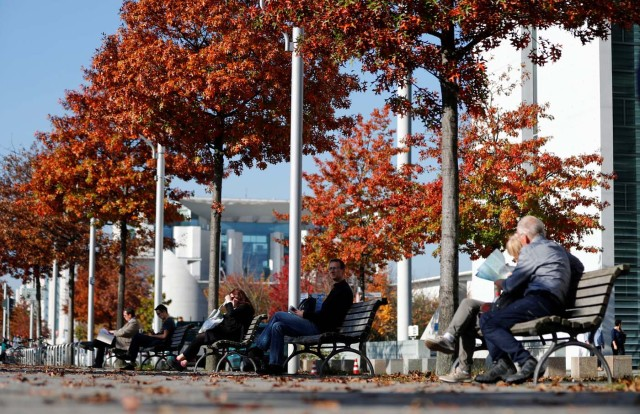 Autumn colours are seen as people relax in the sun at the governmental district in Berlin, Germany, October 17, 2017. REUTERS/Fabrizio Bensch