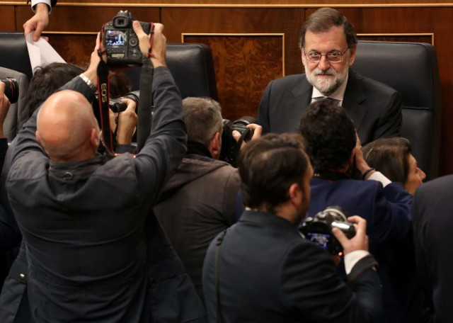 Spain's Prime Minister Mariano Rajoy sits before taking part in the weekly cabinet control session at Parliament in Madrid, Spain, October 25, 2017.  REUTERS/Sergio Perez     TPX IMAGES OF THE DAY