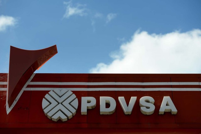 """Picture of the logo of Venezuelan state-owned oil company PDVSA, seen at a gas station in Caracas, on November 14, 2017. Venezuela has been declared in """"selective default"""" by Standard and Poor's after failing to make interest payments on bond issues as it tries to refinance its $150 billion foreign debt. / AFP PHOTO / Federico PARRA"""
