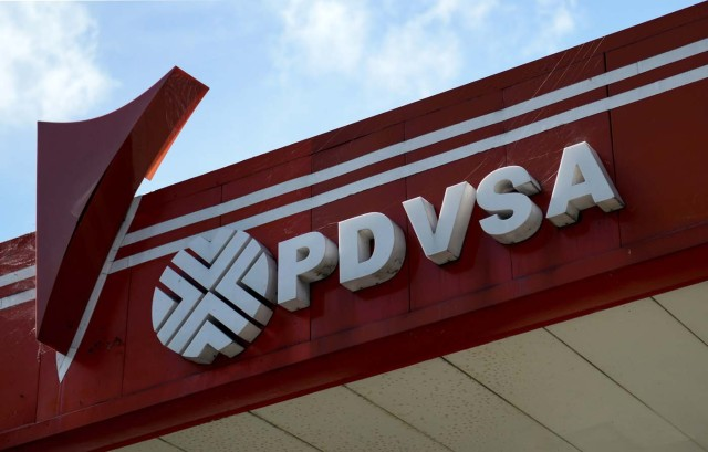 "Picture of the logo of Venezuelan state-owned oil company PDVSA, seen at a gas station in Caracas, on November 14, 2017. Venezuela has been declared in ""selective default"" by Standard and Poor's after failing to make interest payments on bond issues as it tries to refinance its $150 billion foreign debt. / AFP PHOTO / Federico PARRA"
