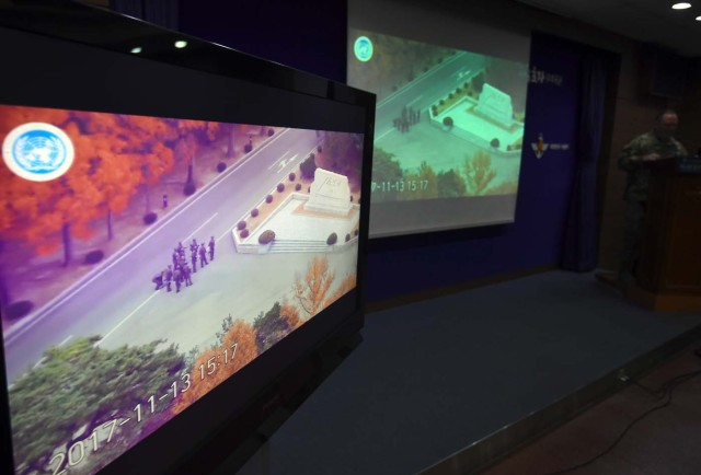 United Nations Command spokesman Colonel Chad G. Carroll shows a surveillance TV footage containing the moment of defection of a North Korean Soldier, during a press briefing at the Defence Ministry in Seoul on November 22, 2017. A North Korean soldier crossed the border into the South in breach of a 1953 armistice agreement as he pursued a defector who was shot last week, the US-led United Nations Command (UNC) said on November 22. / AFP PHOTO / JUNG Yeon-Je