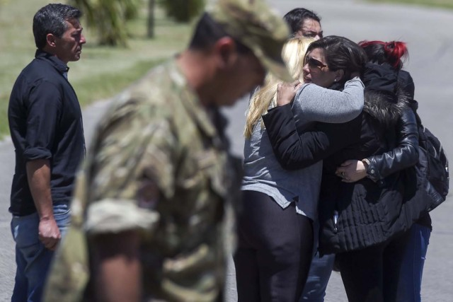 "Relatives and comrades of 44 crew members of Argentine missing submarine, express their grief as they arrive at Argentina's Navy base in Mar del Plata, on the Atlantic coast south of Buenos Aires, on November 23, 2017. An unusual noise heard in the ocean near the last known position of the San Juan submarine was ""consistent with an explosion,"" Argentina's navy announced Thursday. ""An anomalous, singular, short, violent and non-nuclear event consistent with an explosion,"" occurred shortly after the last communication of the San Juan and its 44 crew, navy spokesman Captain Enrique Baldi told a news conference in Buenos Aires. / AFP PHOTO / EITAN ABRAMOVICH"