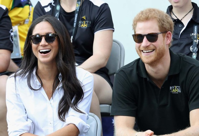 (FILES) This file photo taken on September 25, 2017 shows Britain's Prince Harry (R) and Meghan Markle (L) attend a Wheelchair Tennis match during the Invictus Games 2017 at Nathan Philips Square on September 25, 2017 in Toronto, Canada. Britain's Prince Harry will marry his US actress girlfriend Meghan Markle early next year after the couple became engaged earlier this month, Clarence House announced on November 27, 2017. / AFP PHOTO / GETTY IMAGES NORTH AMERICA / Chris Jackson