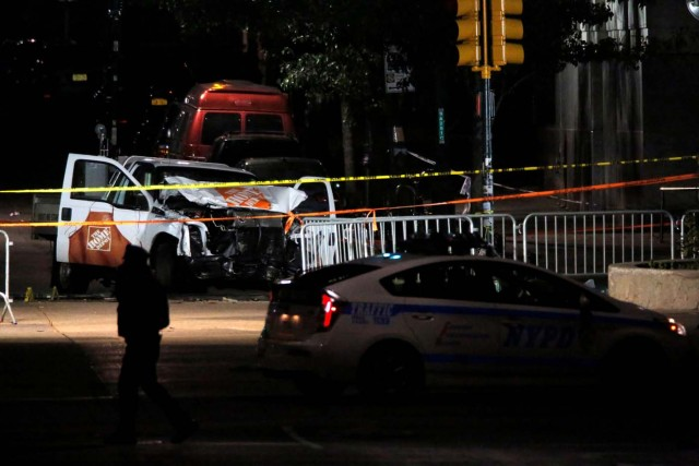 The pickup truck used in an attack on the West Side Highway sits behind police tape in Manhattan, New York, U.S., November 1, 2017. REUTERS/Andrew Kelly