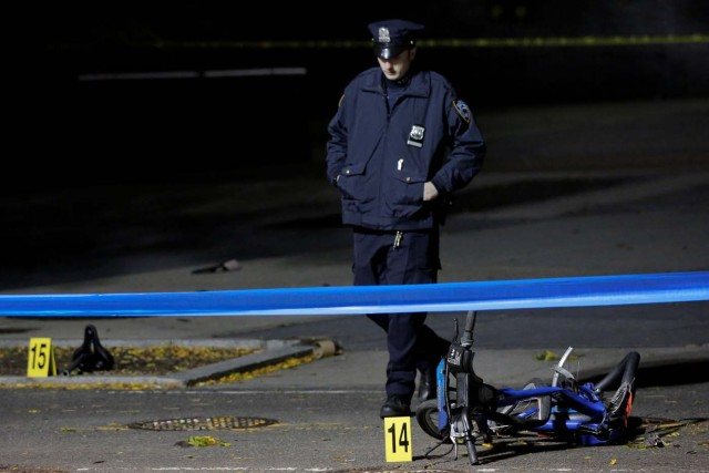 A police officer investigates crushed bicycles on a bicycle lane the day after a pickup truck attack on the West Side Highway in Manhattan, New York, U.S., November 1, 2017. REUTERS/Andrew Kelly