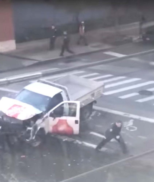 A police officer is seen running away from the pickup truck that mowed down pedestrians and cyclists on a bike path alongside the Hudson River after the attack, in New York City, NY, U.S., in this still image from a video obtained from social media October 31, 2017. TAWHID KABIR XISAN via REUTERS THIS IMAGE HAS BEEN SUPPLIED BY A THIRD PARTY. MANDATORY CREDIT. NO RESALES. NO ARCHIVES. MUST ON SCREEN COURTESY TAWHID KABIR XISAN