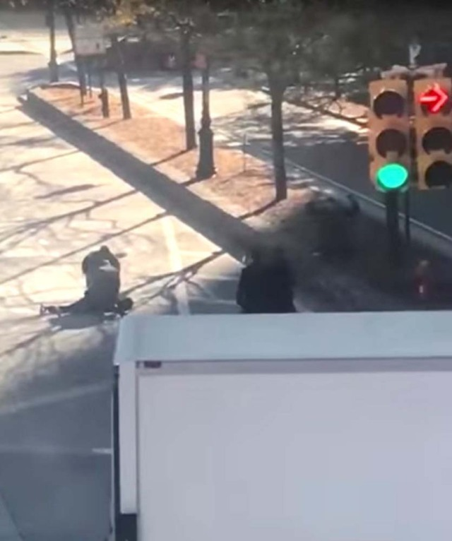 Police officers are seen surrounding someone on the ground in the middle of a road after a pickup truck mowed down pedestrians and cyclists on a bike path alongside the Hudson River, in New York City, NY, U.S., in this still image from a video obtained from social media October 31, 2017. TAWHID KABIR XISAN via REUTERS THIS IMAGE HAS BEEN SUPPLIED BY A THIRD PARTY. MANDATORY CREDIT. NO RESALES. NO ARCHIVES. MUST ON SCREEN COURTESY TAWHID KABIR XISAN