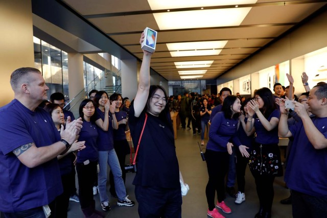 One of the first customers shows his new iPhone X after buying it at an Apple Store in Beijing, China November 3, 2017. REUTERS/Damir Sagolj