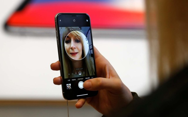 A customer uses the new face-recognition software on the new iPhone X inside the Apple Store in Regents Street in London, Britain, November 3, 2017. REUTERS/Peter Nicholls