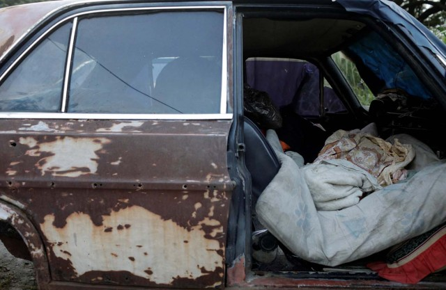 """The bed of Eduardo Liendo, 63, who lives inside an old car is pictured on the outskirts of Caracas, Venezuela, October 13, 2017. REUTERS/Ricardo Moraes SEARCH """"MORAES GAMBLING"""" FOR THIS STORY. SEARCH """"WIDER IMAGE"""" FOR ALL STORIES."""