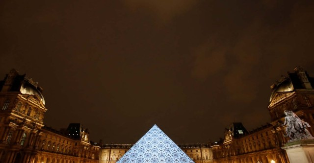 An image depicting the roof of the new Louvre Abu Dhabi museum is projected on the Louvre Pyramid in Paris, France, November 8, 2017. REUTERS/Christian Hartmann
