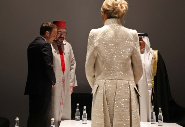 Brigitte Macron stands as French President Emmanuel Macron (L) speaks with Moroccan King Mohammed VI during the visit to the Louvre Abu Dhabi Museum during its inauguration in Abu Dhabi, UAE,November 8, 2017 REUTERS/Ludovic Marin/Pool