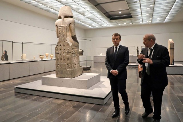 French President Emmanuel Macron (L) and French Foreign Minister Jean-Yves Le Drian visit the Louvre Abu Dhabi Museum during its inauguration in Abu Dhabi, November 8, 2017. REUTERS/Ludovic Marin/Pool