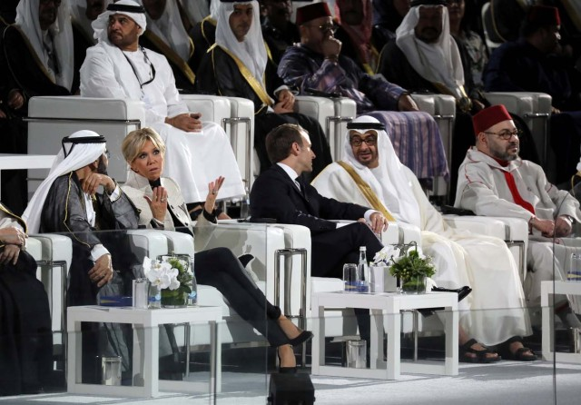 French President Emmanuel Macron (C-R) and his wife Brigitte Macron (C-L) speak with Abu Dhabi Crown Prince Mohammed bin Zayed al-Nahyan (R) and Ruler of Dubai Sheikh Mohammed bin Rashid al-Maktoum during the inauguration of the Louvre Abu Dhabi Museum in Abu Dhabi, UAE, November 8, 2017.   Picture taken November 8, 2017.   REUTERS/Ludovic Marin/Pool