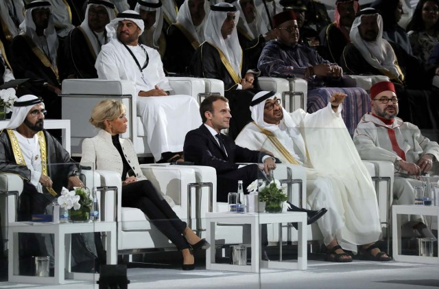 French President Emmanuel Macron (C-R) and his wife Brigitte Macron (C-L) speak with Abu Dhabi Crown Prince Mohammed bin Zayed al-Nahyan and Ruler of Dubai Sheikh Mohammed bin Rashid al-Maktoum during the inauguration of the Louvre Abu Dhabi Museum in Abu Dhabi, UAE, November 8, 2017. Picture taken November 8, 2017. REUTERS/Ludovic Marin/Pool