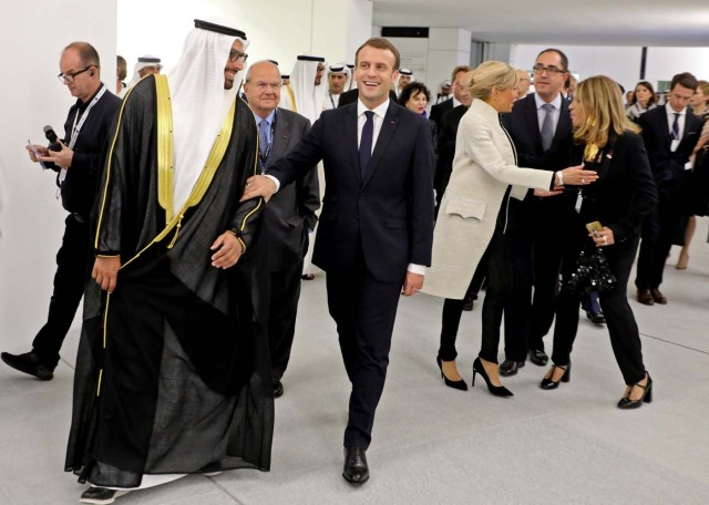 (From L-R) Chairman of Abu Dhabi's Tourism and Culture Authority Mohamad Khalifa al-Mubarak, French President Emmanuel Macron, his wife Brigitte, and Marie-Christine Saragosse, president of France Medias Monde, visit the Louvre Abu Dhabi Museum during its inauguration in Abu Dhabi, UAE, November 8, 2017. Picture taken November 8, 2017. REUTERS/Ludovic Marin