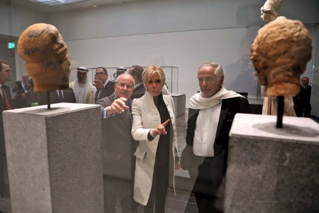 Brigitte Macron, the wife of the French president, looks at art as she visits the Louvre Abu Dhabi Museum during its inaugurationin Abu Dhabi, UAE, November 8, 2017. Picture taken November 8, 2017. REUTERS/Ludovic Marin/Pool
