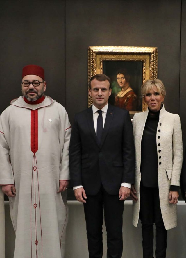 French President Emmanuel Macron (C), his wife Brigitte (R) and Moroccan King Mohammed VI visit the Louvre Abu Dhabi Museum during its inauguration in Abu Dhabi, UAE, November 8, 2017. Picture taken November 8, 2017. REUTERS/Ludovic Morin/Pool
