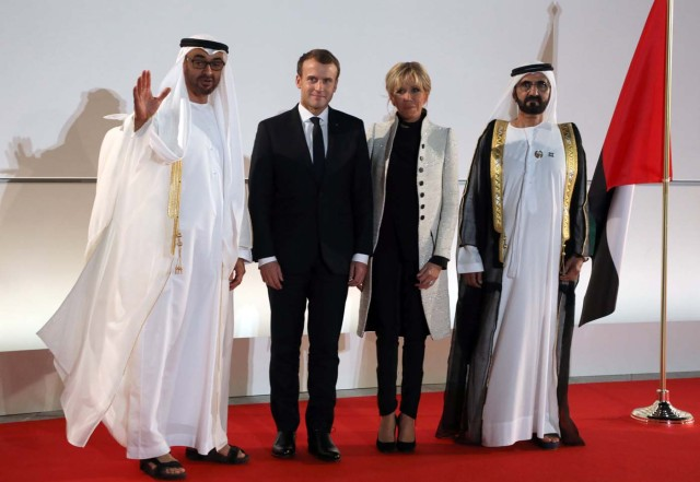 (From L-R) Abu Dhabi Crown Prince Mohammed bin Zayed al-Nahyan, French President Emmanuel Macron, his wife Brigitte Macron and Ruler of Dubai Sheikh Mohammed bin Rashid al-Maktoum pose at the entrance of the Louvre Abu Dhabi Museum during its inauguration in Abu Dhabi, UAE, November 8, 2017. Picture taken November 8, 2017. REUTERS/Ludovic Marin/Pool