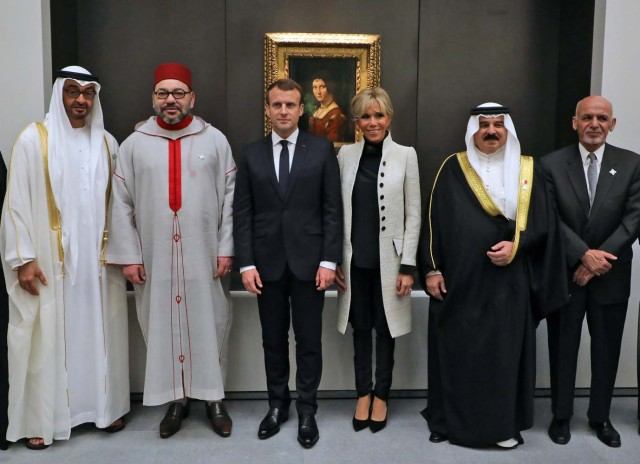 (From L-R) Abu Dhabi Crown Prince Mohammed bin Zayed Al-Nahyan, Moroccan King Mohammed VI, French President Emmanuel Macron, his wife Brigitte, Bahrain's King Hamed bin Isa al-Khalifa and Afghan President Ashraf Ghani pose for a photo as they visit the Louvre Abu Dhabi Museum during its inauguration in Abu Dhabit, UAE, November 8, 2017. Picture taken November 8, 2017. REUTERS/Ludovic Morin/Pool