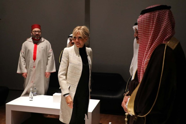 Brigitte Macron, the wife of the French president and Moroccan King Mohammed VI (L) visit the Louvre Abu Dhabi Museum during its inauguration in Abu Dhabi, UAE, November 8, 2017. Picture taken November 8, 2017. REUTERS/Ludovic Marin/Pool