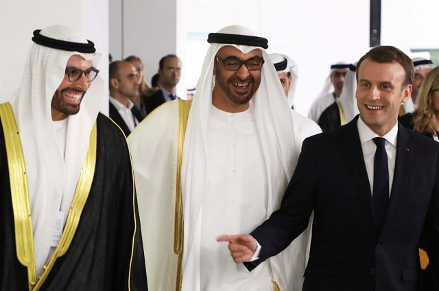 (From L to R) Chairman of Abu Dhabi's Tourism and Culture Authority, Mohamad Khalifa al-Mubarak, Abu Dhabi Crown Prince Mohammed bin Zayed al-Nahyan and French President Emmanuel Macron laugh as they visit the Louvre Abu Dhabi Museum during its inauguration in Abu Dhabi, UAE, November 8, 2017. Picture taken November 8, 2017. REUTERS/Ludovic Marin/Pool