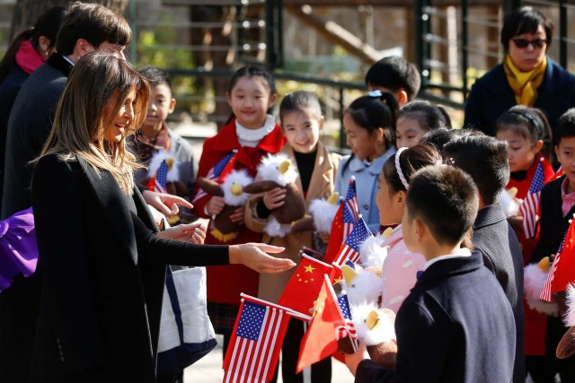 U.S. first lady Melania Trump talks to children during her visit to Beijing Zoo in Beijing, China, November 10, 2017. REUTERS/Thomas Peter