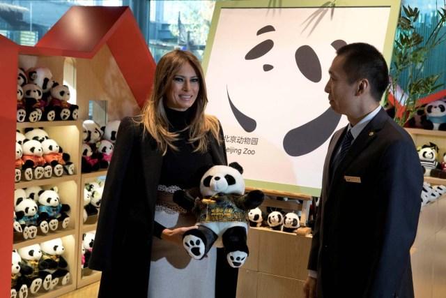 U.S. first lady Melania Trump poses with a panda plushie after visiting the panda enclosure at the zoo in Beijing, China, November 10, 2017. REUTERS/Ng Han Guan/Pool