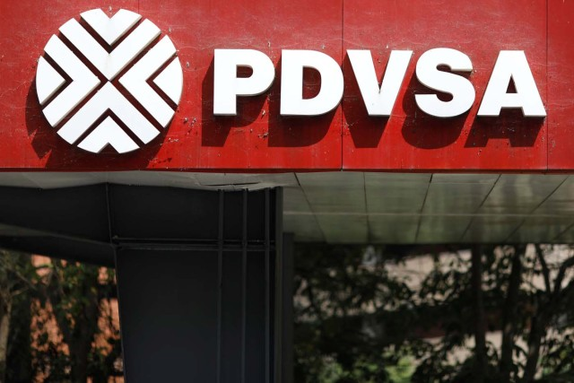 The corporate logo of the state oil company PDVSA is seen at a gas station in Caracas, Venezuela November 16, 2017. REUTERS/Marco Bello