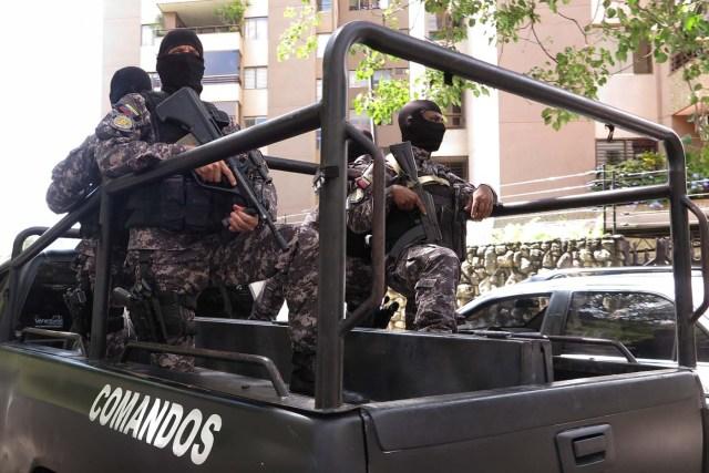 Members of the Bolivarian National Intelligence Service (SEBIN) are seen outside the house of Venezuela's opposition leader Antonio Ledezma in Caracas, Venezuela November 17, 2017. REUTERS/Christian Veron